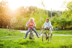 Beautiful,Senior,Couple,With,Bicycles,Outside,In,Spring,Nature.